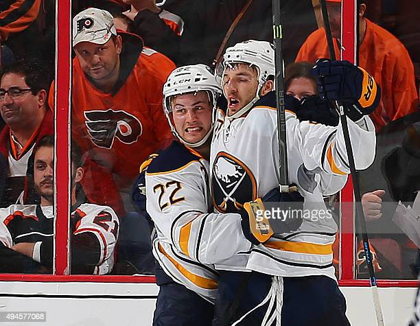 Zemgus Girgensons of the Buffalo Sabres celebrates his game winning goal with teammate Johan Larsson in overtime against the Philadelphia Flyers on...