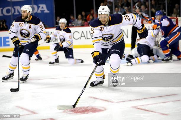 Zemgus Girgensons of the Buffalo Sabres chases the puck in the second period against the New York Islanders at Barclays Center on October 7 2017 in...
