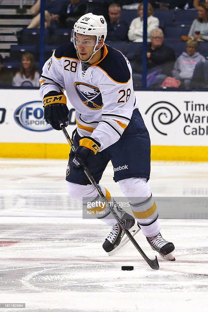 Zemgus Girgensons #28 of the Buffalo Sabres controls the puck during the preseason game against the Columbus Blue Jackets on September, 2013 at Nationwide Arena in Columbus, Ohio.