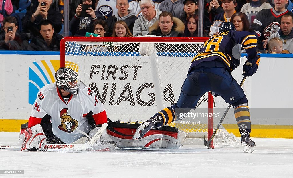 Zemgus Girgensons #28 of the Buffalo Sabres scores the game winning shootout goal against Robin Lehner #40 of the Ottawa Senators on December 10, 2013 at the First Niagara Center in Buffalo, New York. Buffalo won, 2-1.