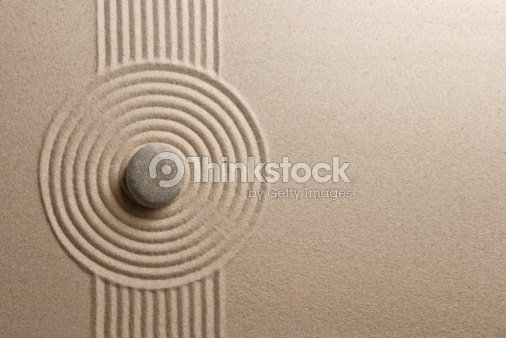 A Zen garden with a very unique and well made design in it  : Stock Photo