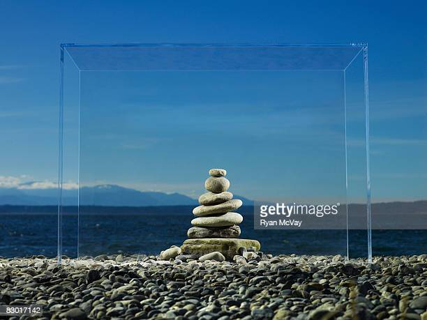 zen rocks at beach in glass box