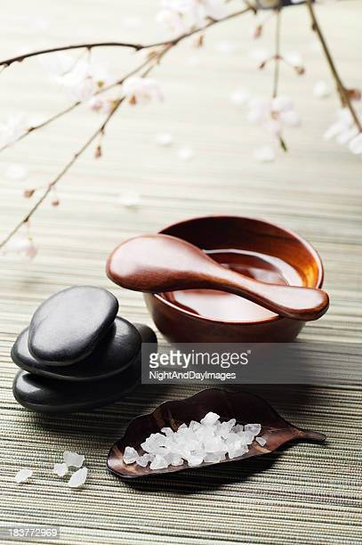 Zen spa healing items for rejuvenation on a bamboo surface