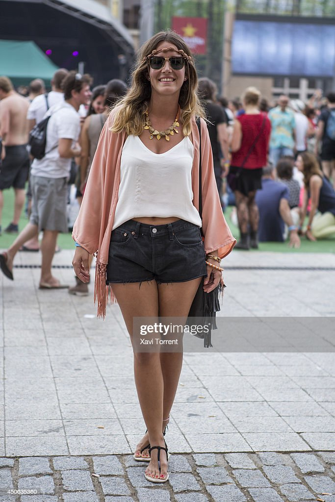 Zenaida is wearing a jacket from Nora.Z, pants from Levis, sandals from Lefties, bag from Primark and sunglasses Rayban at the Sonar Music Festival on June 14, 2014 in Barcelona, Spain.