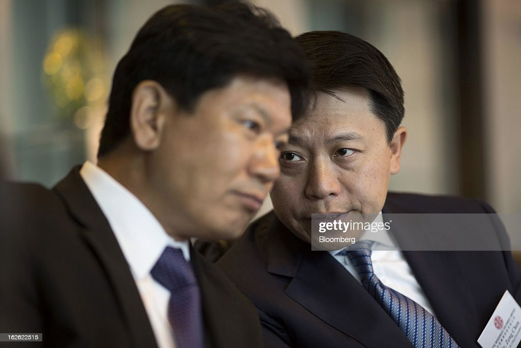 Zeng Chen, chief executive officer and co-vice chairman of Citic Resources Holdings Ltd., right, speaks with Yang Zaiyan, vice president, during a news conference in Hong Kong, China, on Monday, Feb. 25, 2013. Citic Resources Holdings Ltd., a Chinese oil and coal producer, reported full year net loss of HK$1.26 billion before adjustments. Photographer: Jerome Favre/Bloomberg via Getty Images