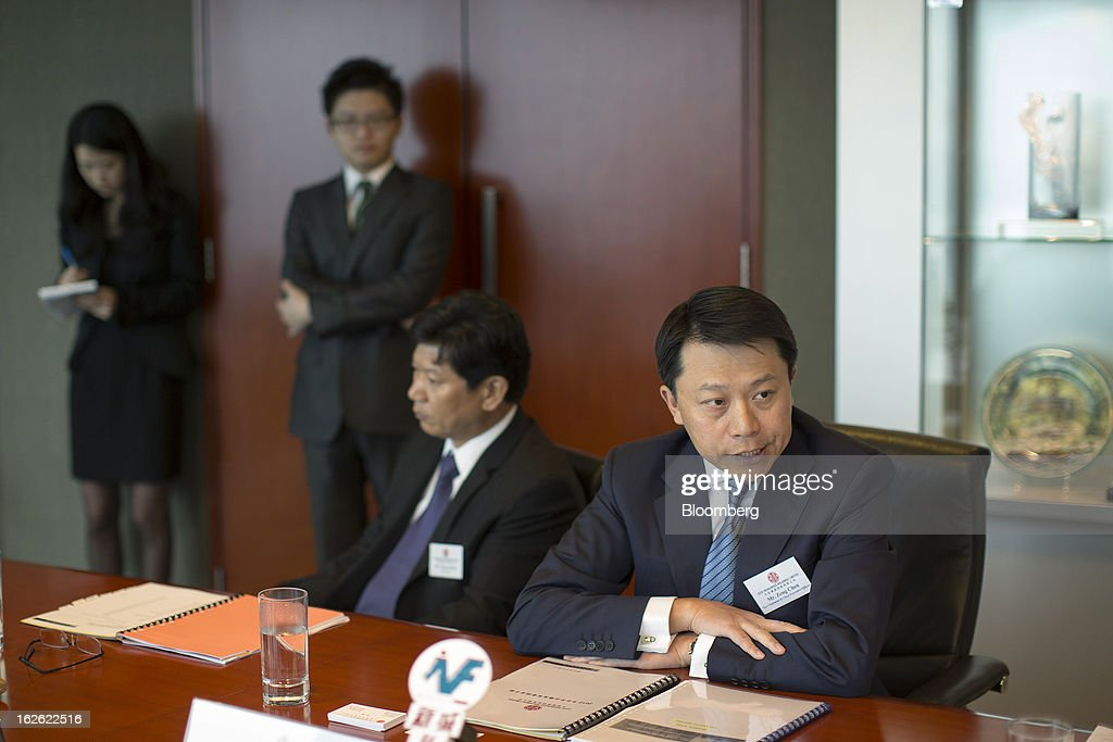 Zeng Chen, chief executive officer and co-vice chairman of Citic Resources Holdings Ltd., right, speaks as Yang Zaiyan, vice president, second right, looks on during a news conference in Hong Kong, China, on Monday, Feb. 25, 2013. Citic Resources Holdings Ltd., a Chinese oil and coal producer, reported full year net loss of HK$1.26 billion before adjustments. Photographer: Jerome Favre/Bloomberg via Getty Images