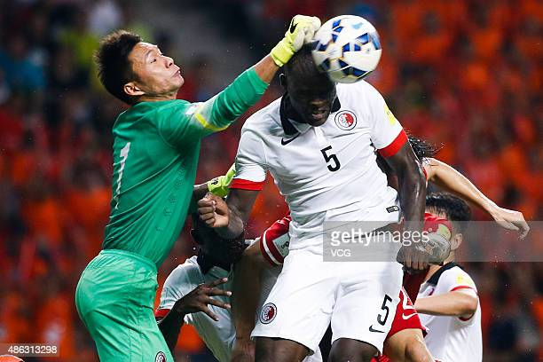 Zeng Cheng of China vies with JeanJacques Kilama of Hong Kong during a group match between China and Hong Kong as a part of 2018 FIFA World Cup...