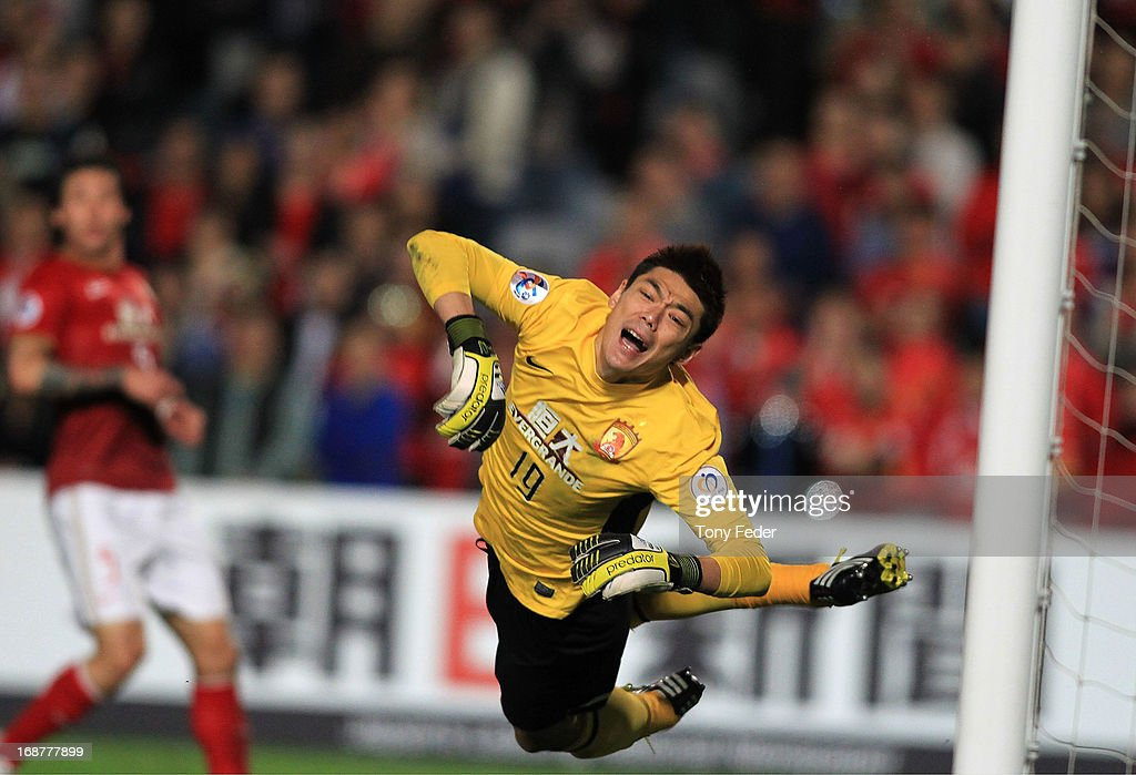 Zeng Cheng of Evergrande dives in an attempt to save the ball during the AFC Asian Champions League match between the Central Coast Mariners and Guangzhou Evergrande at Bluetongue Stadium on May 15, 2013 in Gosford, Australia.
