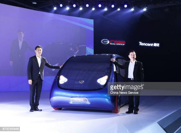 Zeng Qinghong Chairman of GAC Group and Pony Ma Huangteng chairman and chief executive officer of Tencent Holdings Ltd pose with the iSPACE electric...
