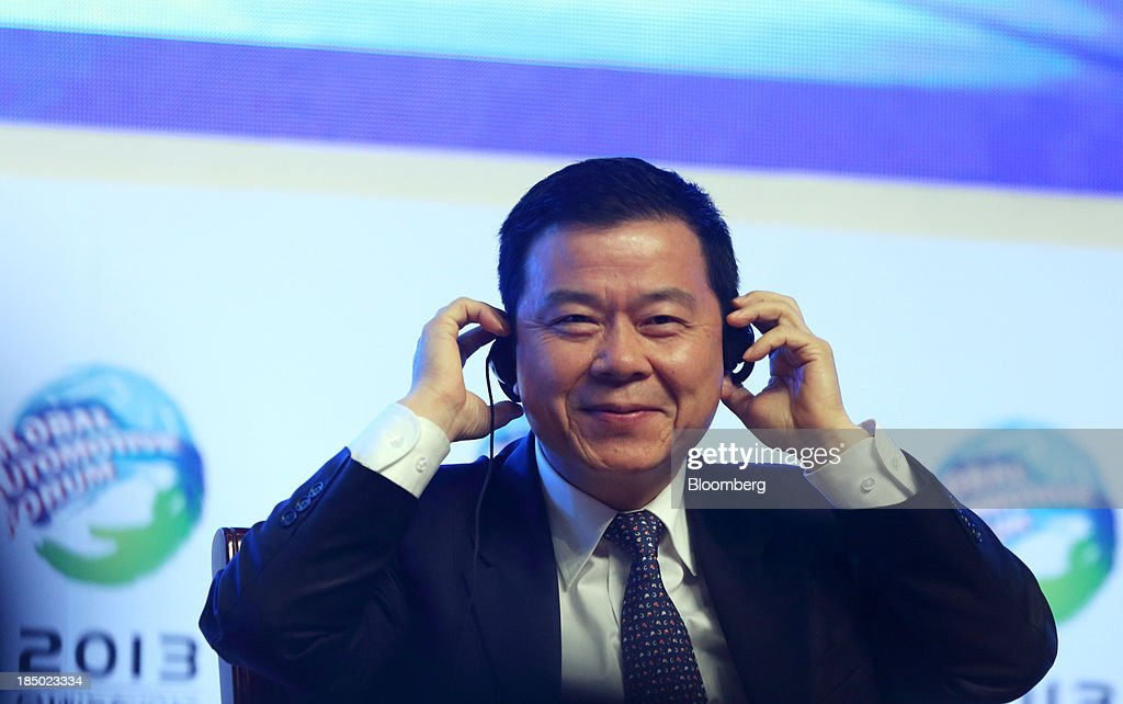 Zeng Qinghong, general manager of Guangzhou Automobile Group Co., adjusts his headphones at the Global Automotive Forum in Wuhan, China, on Thursday, Oct. 17, 2013. The forum will be held through Oct. 18. Photographer: Tomohiro Ohsumi/Bloomberg via Getty Images