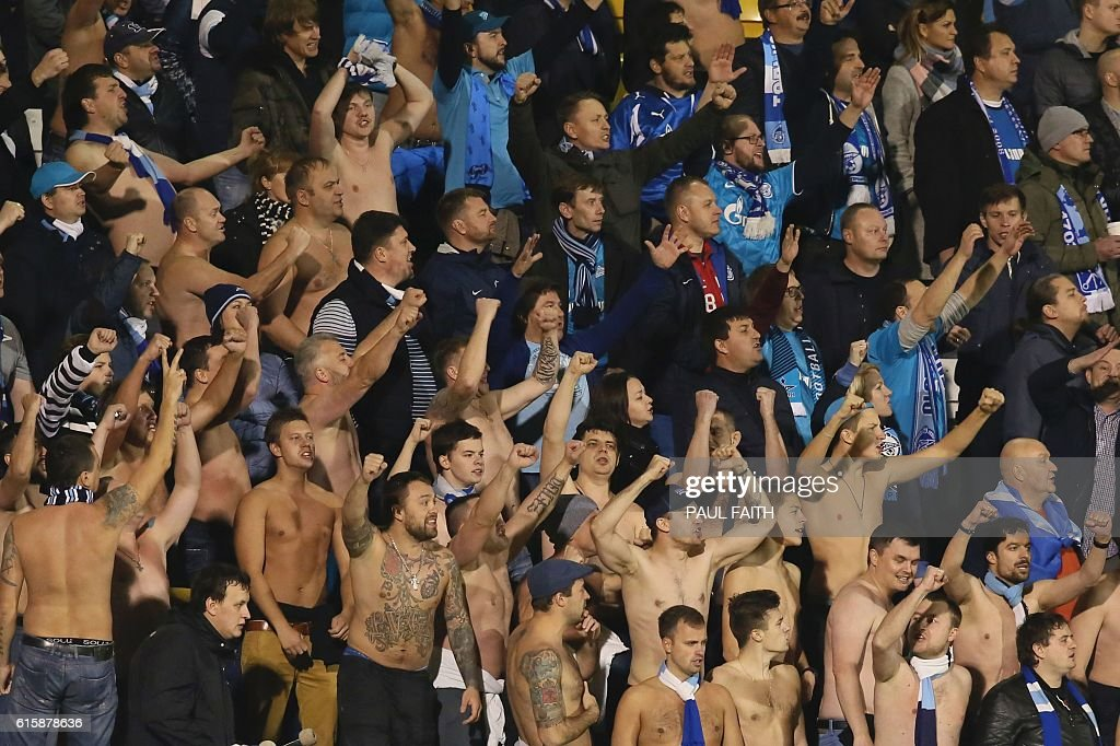 Zenit Saint Petersburg supporters cheer in the crowd during the UEFA Europa League group D football match between Dundalk and Zenit Saint Petersburg at Tallaght Stadium in Dublin on October 20, 2016. / AFP / PAUL