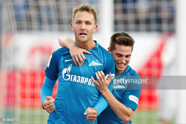 Zenit St Petersburg players Domenico Criscito celebrates with Robert Mak after scoring his goal during the Russian Football League match between FC...