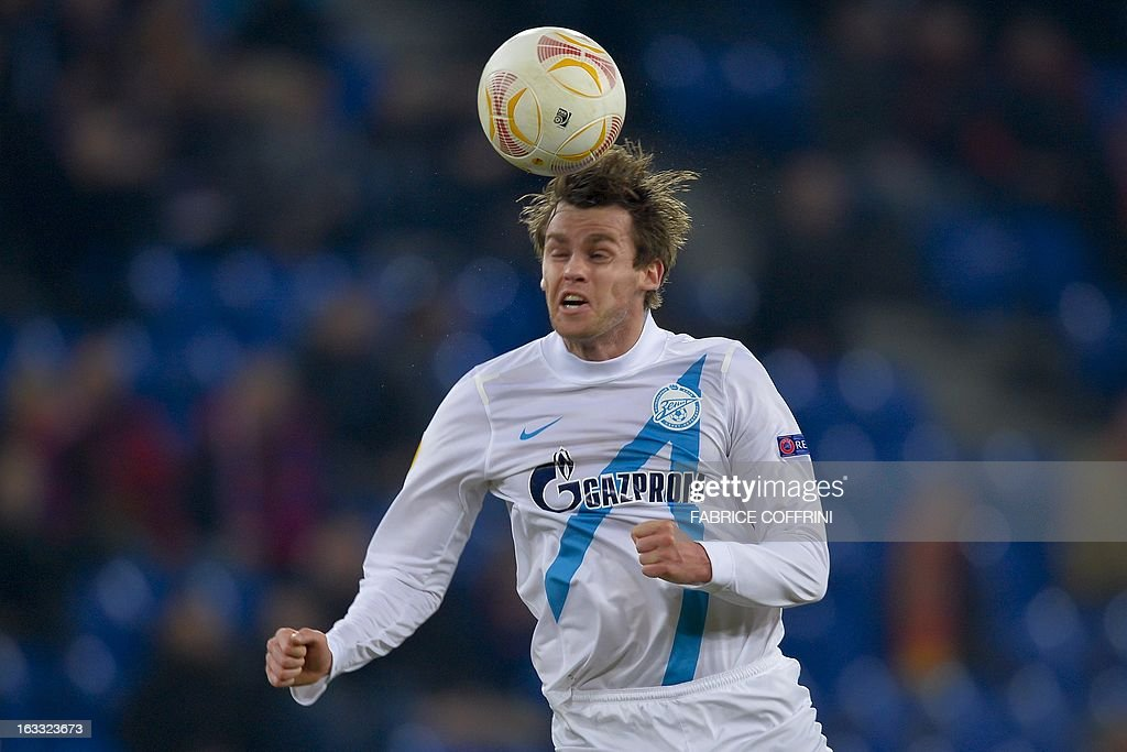 Zenit St. Petersburg's Belgian defender Nicolas Lombaerts heads a ball on March 7, 2013 during a UEFA Europa League round of 16 first leg football match against FC Basel in Basel. AFP PHOTO / FABRICE COFFRINI