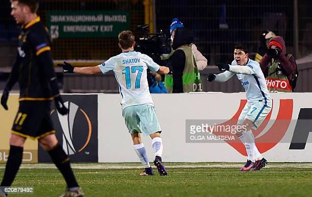 Zenit St Petersburg's Brazilian midfielder Giuliano celebrates after scoring a goal during the UEFA Europa League group D football match between FC...