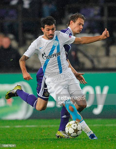 FC Zenit St Petersburg's Danny fights for the ball with Anderlecht's Guillaume Gillet on November 6 2012 during a Champions League group C football...