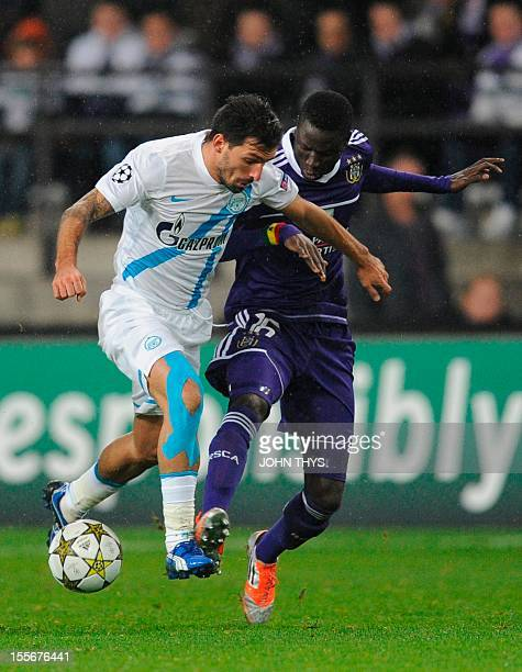 FC Zenit St Petersburg's Danny fights for the ball with Anderlecht's Cheikhou Kouyate on November 6 2012 during a Champions League group C football...