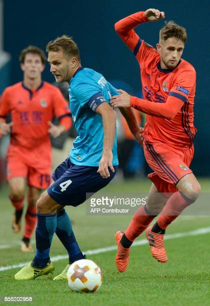 Zenit St Petersburg's defender from Italy Domenico Criscito and Real Sociedad's midfielder from Belgium Adnan Januzaj vie for the ball during the...