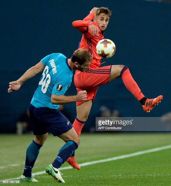 Zenit St Petersburg's defender from Serbia Branislav Ivanovic and Real Sociedad's midfielder from Belgium Adnan Januzaj vie for the ball during the...