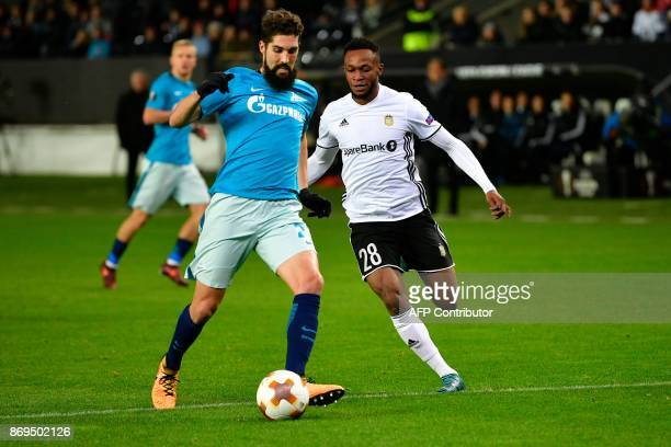Zenit St Petersburg's defender from Slovenia Miha Mevlja and Rosenborg's forward from Nigeria Samuel Adegbenro vie for the ball during the UEFA...