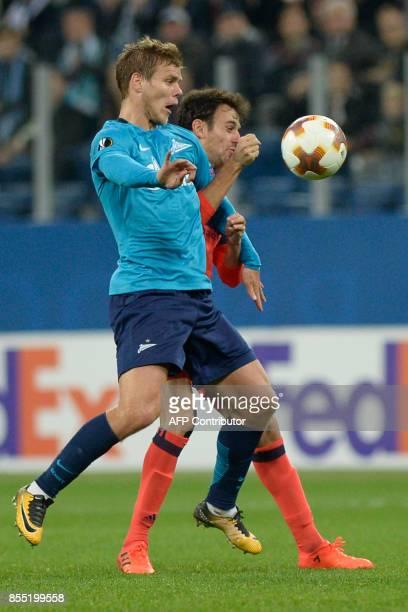 Zenit St Petersburg's forward from Russia Alexander Kokorin and Real Sociedad's midfielder from Spain Ruben Pardo Gutierrez vie for the ball during...