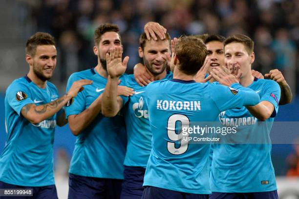 Zenit St Petersburg's forward from Russia Alexander Kokorin celebrates with teammates after scoring the team's third goal during the UEFA Europa...