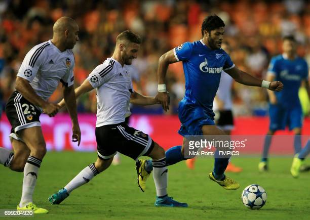 Zenit St Petersburg's Hulk battles through the challenge from Valencia's Shkodran Mustafi