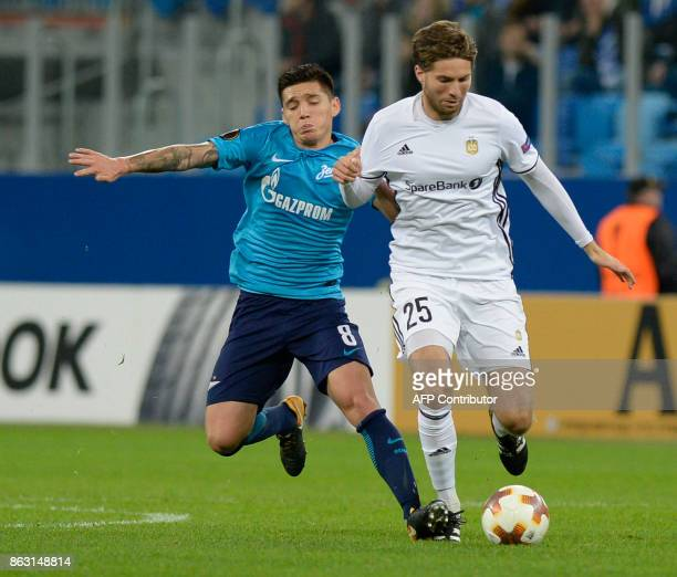 Zenit St Petersburg's midfielder from Argentina Claudio Kranevitter and Rosenborg's midfielder from Norway Marius Lundemo vie for the ball during the...