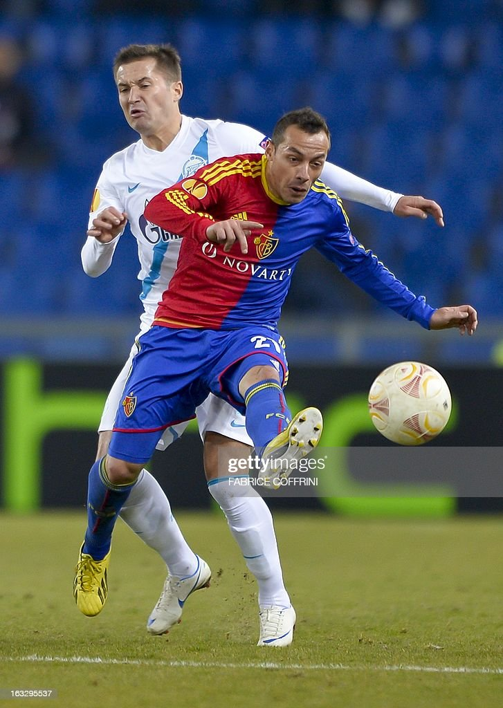 Zenit St. Petersburg's Serbian defender Milan Rodic (L) vies FC Basel's Chilean midfielder Marcelo Diaz during the UEFA Europa League round of 16 first leg football match between FC Basel and Zenit St. Petersburg on March 7, 2013 in Basel.