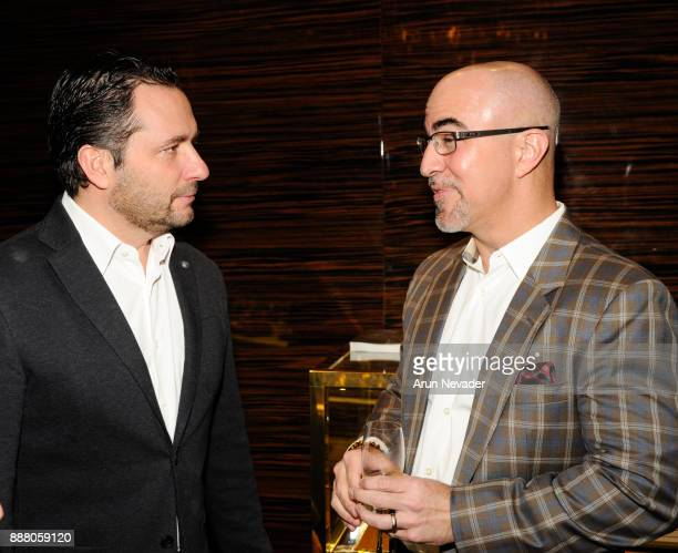 Zenith CEO Julien Tornare and Dr Borges chat during the cocktail reception at Vagu on December 7 2017 in Miami Florida