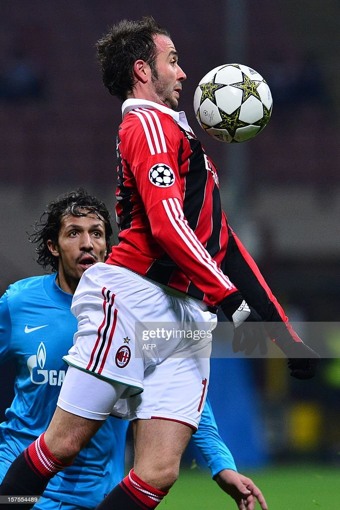 FC Zenith's Portuguese defender Bruno Alves (back) fights for the ball with AC Milan's forward Giampaolo Pazzini during the Champions League match AC Milan vs FC Zenith on December 4, 2012 at the San Siro Stadium in Milan.