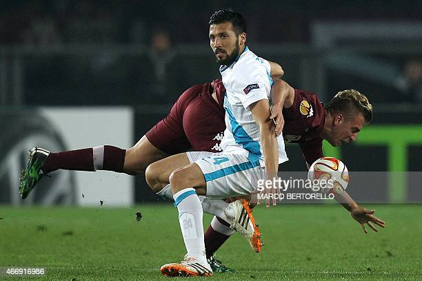Zenit's Argentinian defender Ezequiel Garay fights for the ball with Torino's Argentinian forward Maxi Lopez during the UEFA Europe League round of...