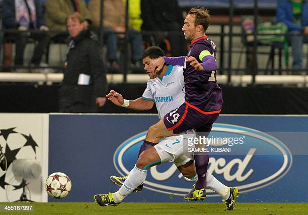 Zenit's Brazilian forward Hulk and Austria Wien's defender Manuel Ortlechner vie for the ball during the UEFA Champions League group G football match...