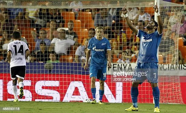 Zenit's Brazilian forward Hulk celebrates his goal during the UEFA Champions League group H football match Valencia CF vs FC Zenit at the Mestalla...
