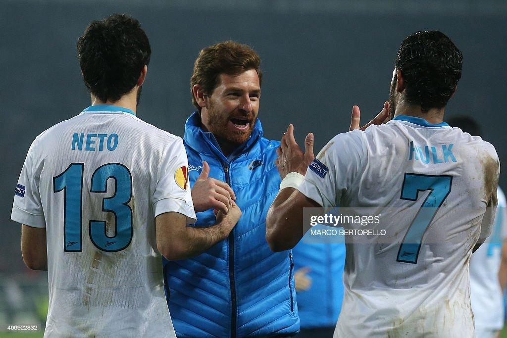 Zenit's coach Andre VillasBoas from Portugal celebrates with Zenit's defender Luis Neto of Portugal and Zenit's Brazilian forward Hulk Givanildo...