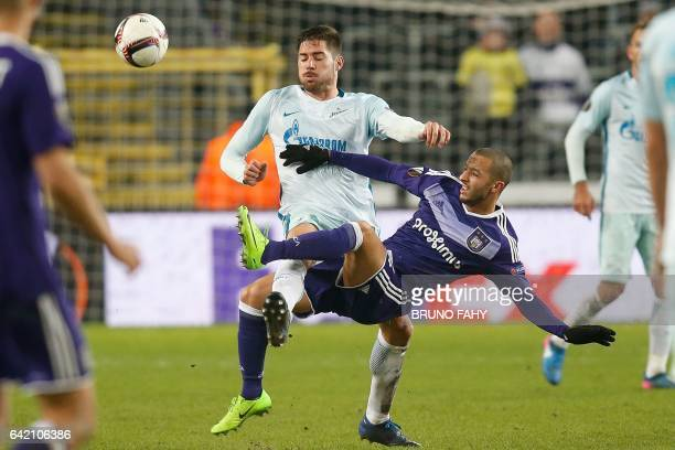 Zenit's defender Javi Garcia and Anderlecht's midfielder Sofiane Hanni go for the ball during the UEFA Europa League football match Anderlecht vs...
