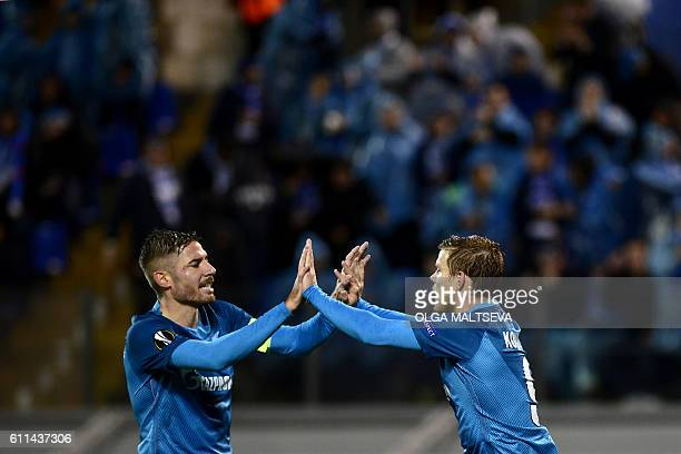 Zenit's forward Aleksandr Kokorin and Zenit's Spanish midfielder Javi Garcia celebrate scoring a goal during the Europa League Group D football match...