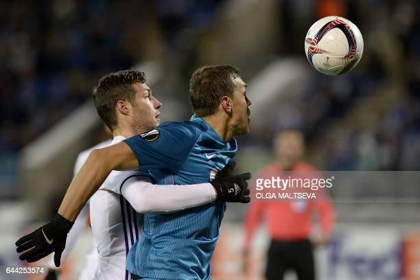 Zenit's forward Aleksandr Kokorin challenges Anderlecht's Serbian defender Uros Spajic during the UEFA Europa League round of 32 football match...