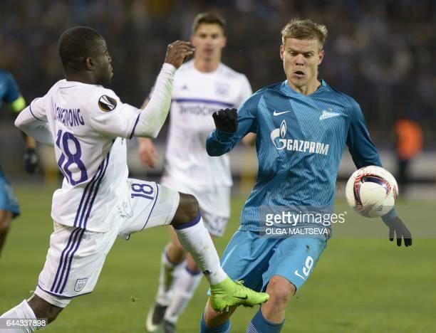 Zenit's forward Aleksandr Kokorin vies with Anderlecht's forward Frank Acheampong during the Europa League football match between Russian FC Zenit...