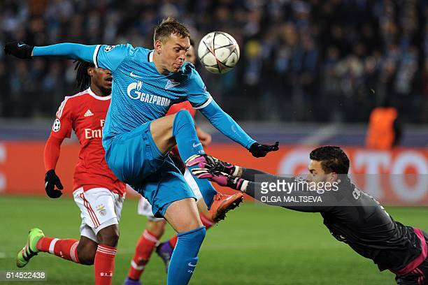 Zenit's forward Artem Dzyuba vies for the ball with Benfica's Brazilian goalkeeper Ederson during the secondleg round of 16 UEFA Champions League...