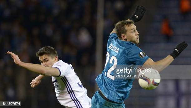 Zenit's forward Artem Dzyuba vies with Andertlecht's Belgian midfielder Leander Dendoncker during their Europa League football match between Russian...