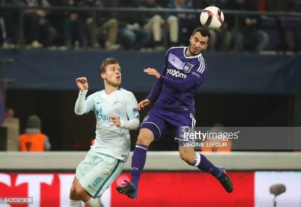 Zenit's forward's Aleksandr Kokorin and Anderlecht's Ivan Obradovic fight for the ball during the UEFA Europa League football match between Belgium's...