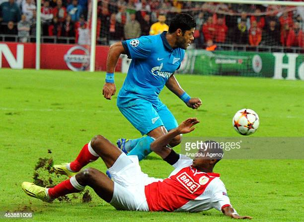 Zenit's Hulk fights for the ball against his rival during the UEFA Champions League playoff first leg match between Standard Liege and Zenit at...