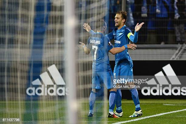 Zenit's Italian defender Domenico Criscito and Zenit's Brazilian forward Giuliano celebrate scoring a goal during the Europa League Group D football...