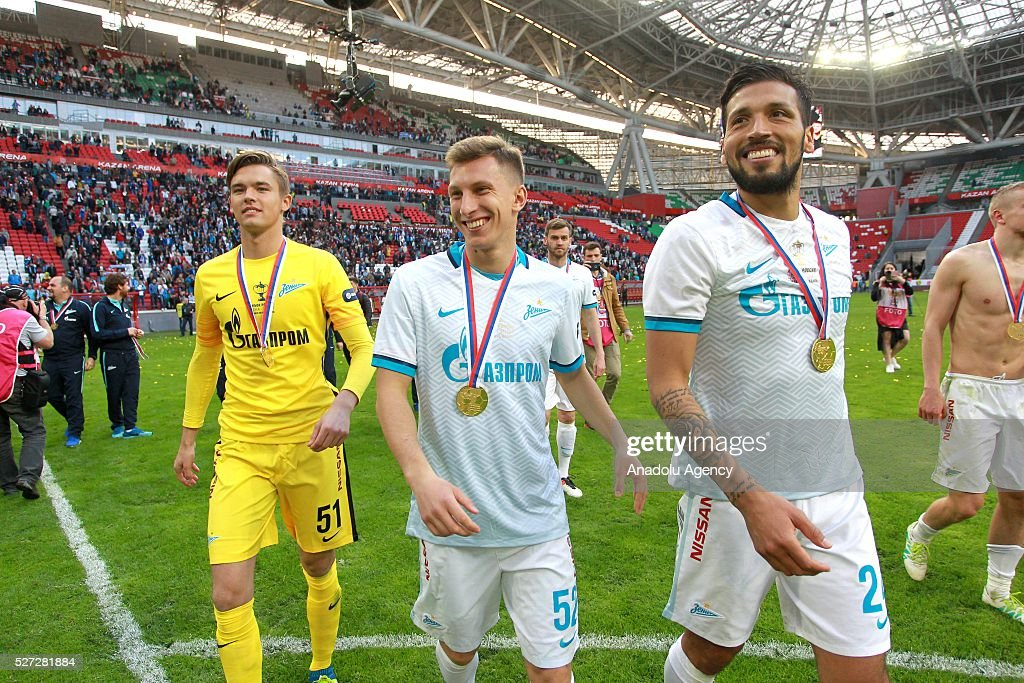 Zenit's Maxim Rudakov, Andrey Ivanov end Ezequiel Garay celebrates their victory with the trophy at an awards ceremony after winning in the 2015/16 Season Russia Cup final match between CSKA and Zenit at Kazan Arena in Kazan, Russia on May 2, 2016. FC Zenit won the game 4:1.
