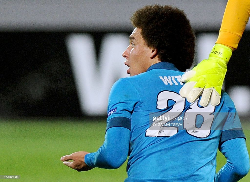 Zenit's midfielder <a gi-track='captionPersonalityLinkClicked' href=/galleries/search?phrase=Axel+Witsel&family=editorial&specificpeople=4345455 ng-click='$event.stopPropagation()'>Axel Witsel</a> reacts during the UEFA Europa League quarter-final second leg football match Zenit Saint Petersburg vs Sevilla FC at Petrovsky stadium in Saint Petersburg on April 23, 2015. AFP PHOTO / OLGA MALTSEVA