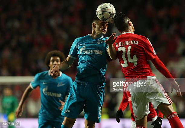 Zenit's midfielder from Brazil Mauricio with SL Benfica's defender Andre Almeida in action during the UEFA Champions League Round of 16 First Leg...