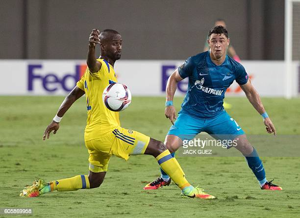 Zenit's midfielder Giuliano has his pass deflected by Maccabi's defender Eli Dasa during their UEFA Europa League Group D football match between...