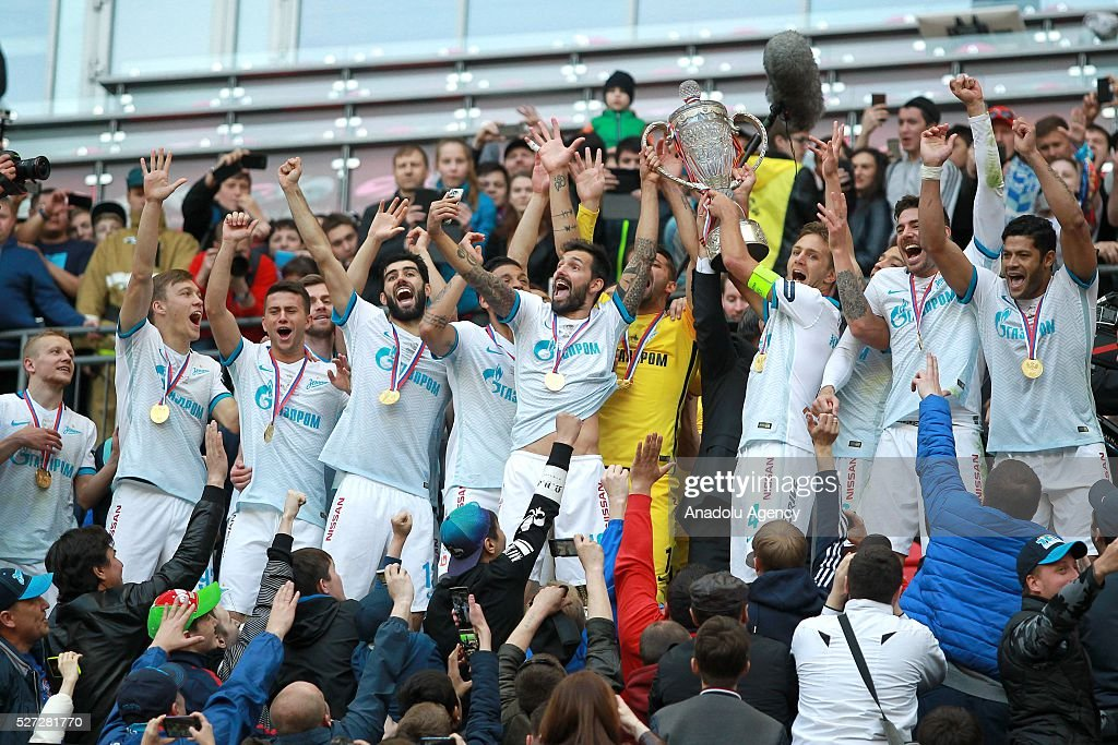 Zenit's players celebrates their victory with the trophy at an awards ceremony after winning in the 2015/16 Season Russia Cup final match between CSKA and Zenit at Kazan Arena in Kazan, Russia on May 2, 2016. FC Zenit won the game 4:1.