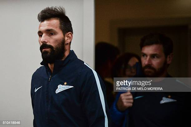 Zenit's Portuguese midfielder Danny Gomes and Zenit's head coach Andre Villas Boas arrive to a press conference at Luz stadium in Lisbon on February...