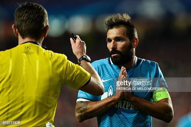 Zenit's Portuguese midfielder Danny Gomes speaks to the referee during the UEFA Champions League round of 16 football match SL Benfica vs FC Zenith...